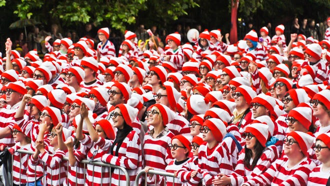 Largest gathering of people dressed as Wally/Waldo: A section of the 3,872, at the Street Performance World Championship in Dublin, Ireland, on June 19, 2011.