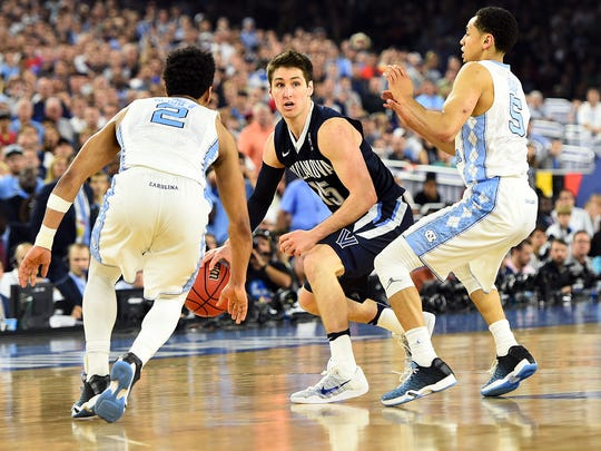 Villanova guard Ryan Arcidiacono (15) handles the ball against North Carolina guard Joel Berry II (2) and guard Marcus Paige (5) during the second half in the championship game of the 2016 NCAA Men's Final Four.
