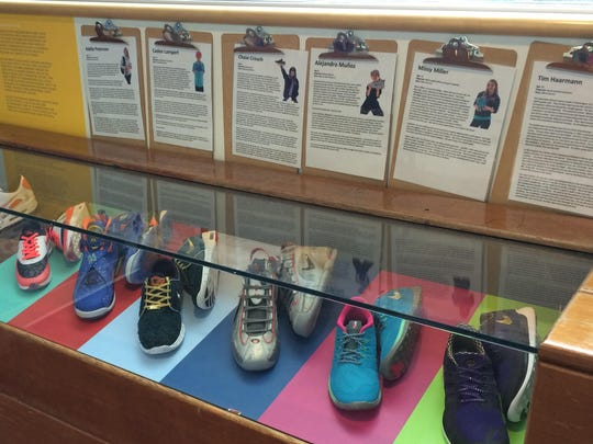 A display of Nike athletic shoes designed in 2014 by patients at Doernbecher Children's Hospital.