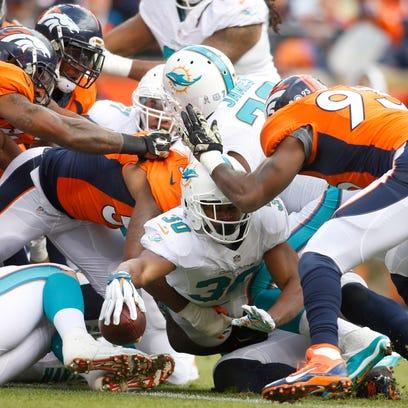 Nov 23, 2014; Denver, CO, USA; Miami Dolphins running