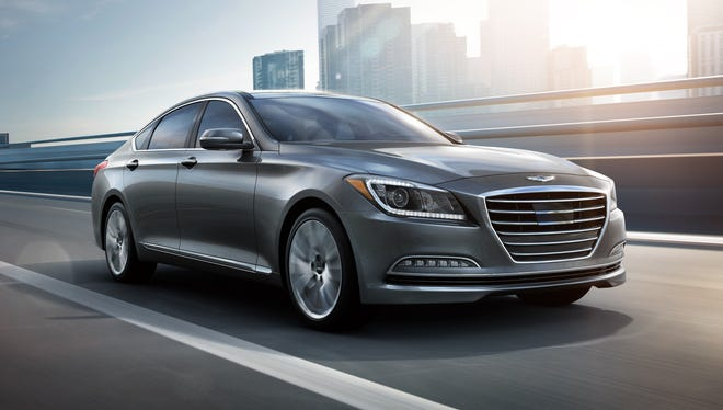 The  2015 Hyundai Genesis 5.0 approaches with LED running lamps, projector beams and LED fog lamps.