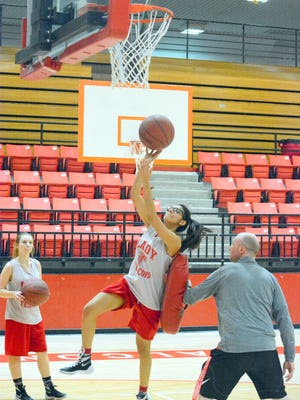 Loving's Arianna Franco works on scoring baskets off penetration during Monday's practice. The Lady Falcons open the 3A state tournament at 6 p.m. Friday at Pecos.