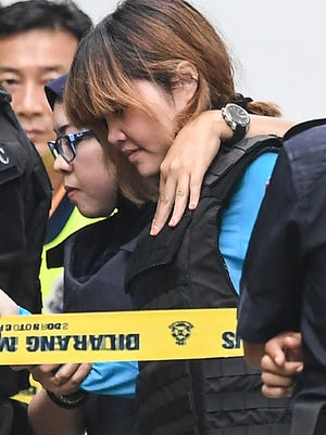 Vietnamese national Doan Thi Huong (right) is escorted by Malaysian police after a court appearance with Indonesian national Siti Aisyah (not pictured) at the magistrates' court in Sepang on April 13, 2017, for their alleged role in the assassination of Kim Jong Nam, the half-brother of North Korean leader Kim Jong Un. Kim Jong-Nam, the half-brother of North Korean leader Kim Jong-Un was assassinated in Malaysia on February 14. / AFP PHOTO / MOHD RASFANMOHD RASFAN/AFP/Getty Images ORIG FILE ID: AFP_NI5WT