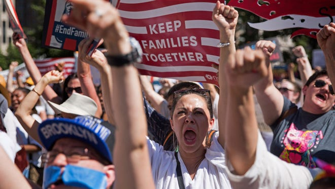 Activists shout during the rally to protest the Trump administration's immigration policies Saturday, on June 30, 2018, in New York.