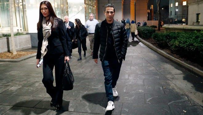"Joseph ""Skinny Joey"" Merlino, right, leaves federal court in Lower Manhattan with his wife, Deborah"
