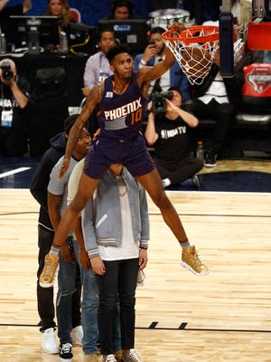 Feb 18, 2017: Phoenix Suns forward Derrick Jones Jr. (10) dunks over his teammates in the slam dunk contest during NBA All-Star Saturday Night at Smoothie King Center.