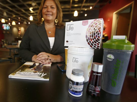 Patty Matlock, Jackson, owns a business called Go Green Think Health, selling nutritional supplements for Shaklee. She is shown with some of her nutritional supplements at Cafe Anna Bella in Wall.