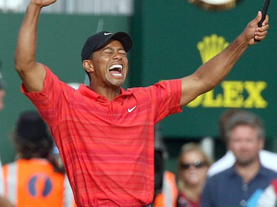 Tiger Woods had plenty to celebrate after holding off Chris DiMarco to win the Open Championship at Royal Liverpool in 2006. (Getty Images)