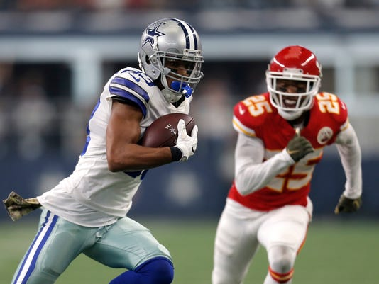 Dallas Cowboys wide receiver Terrance Williams (83) carries the ball after catching a pass as Kansas City Chiefs cornerback Kenneth Acker (25) gives chase in the first half of an NFL football game, Sunday, Nov. 5, 2017, in Arlington, Texas. (AP Photo/Brandon Wade)