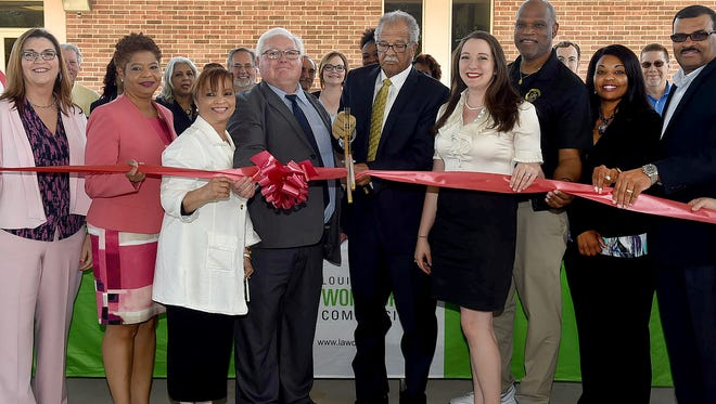 Ribbon cutting held Wednesday to announce the Louisiana Workforce Commissions plans to move 16  agencies under one roof at the St. Landry Parish Community Action building.