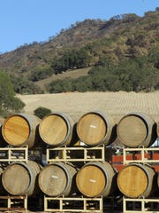 Stacks of empty wine barrels are seen at Old Creek
