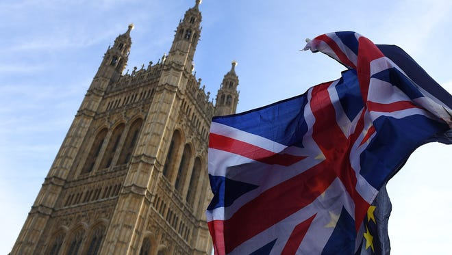 The British Union flag and European Union flag outside parliament in London.