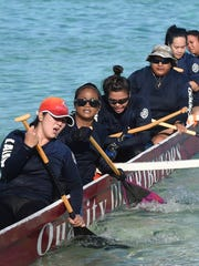 "Team Taotao Galaide's women's division competed in the women's 1500 meter race during the ""Battle in the Bay"" paddling competition at Matapang Beach Park in Tumon on Nov. 15."