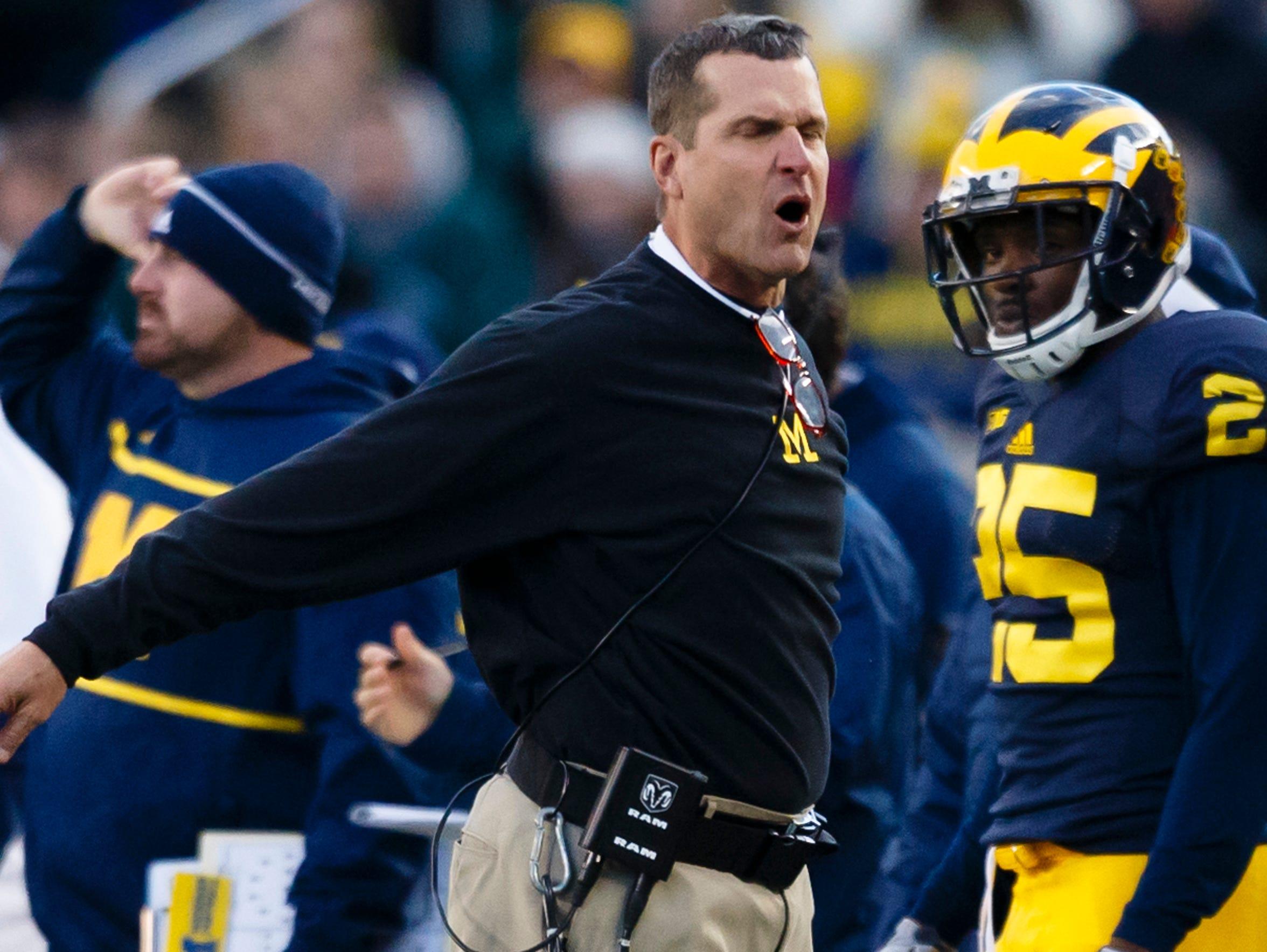 Michigan coach and alum Jim Harbaugh inherited a 5-7