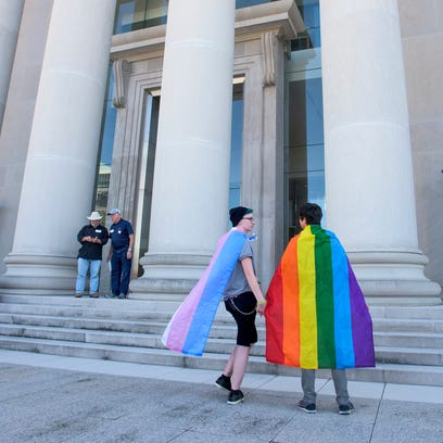 LBGT protesters gather on the steps of the Alabama