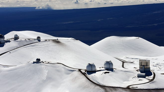 The astronomy observatories atop the snow-capped mountain of Mauna Kea as seen on Jan. 6, 2009, near Hilo, Hawaii.