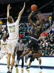 Southern Miss' Bilal Abdur-Rahim (13) gets a shot off against Charlotte last week.
