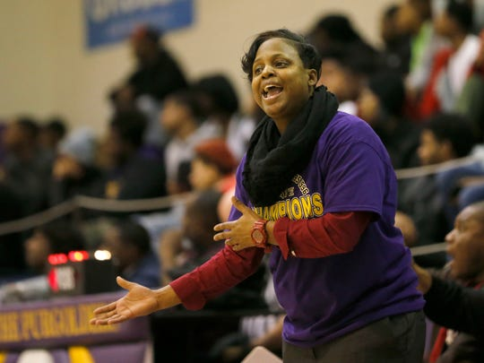 Bay View girls basketball coach Dee Dee Pate, a Washington high school alumna, wears her 1996 championship Washington Purgolders T-shirt.
