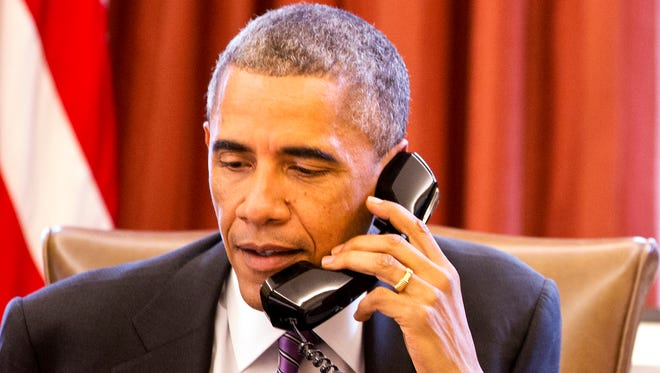 President Obama speaks during a phone call about Ebola in the Oval Office on Oct. 8, 2014.