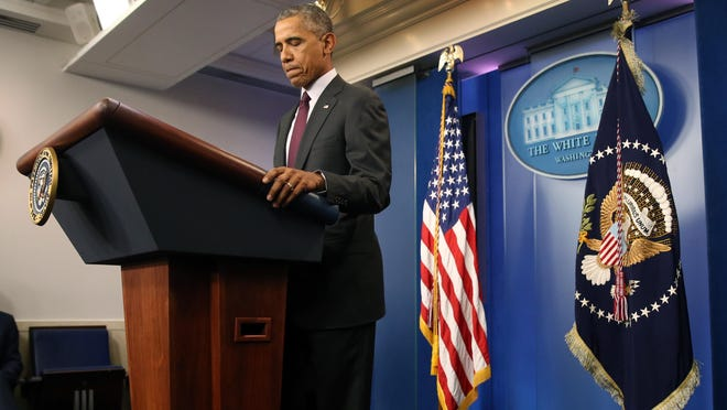 President Barack Obama pauses as he speaks in the Brady Press Briefing Room at the White House in Washington on Thursday, about the shooting at the community college in Oregon. The shooting happened at Umpqua Community College in Roseburg, Ore., about 180 miles south of Portland.