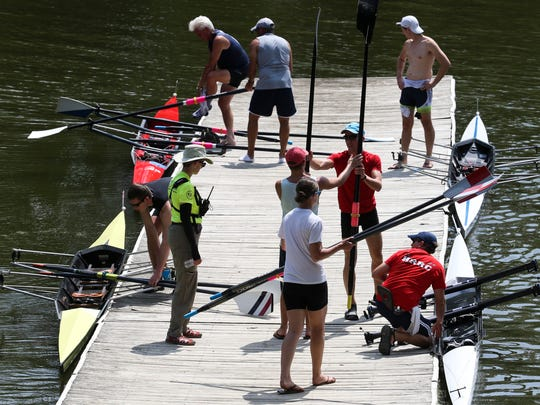 Racers put their shells in the lake as they prepare to compete during the Diamond State Masters Regatta Saturday, the first of two days of racing on Noxontown Lake outside Middletown.