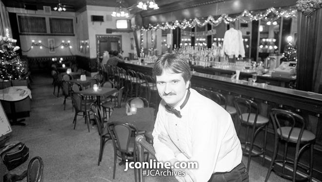"Jeff Wiseman, a bartender at Knickerbocker Saloon, says, "" It's always interesting to be around people and something new happens everyday."" Photo taken Dec. 19, 1984."
