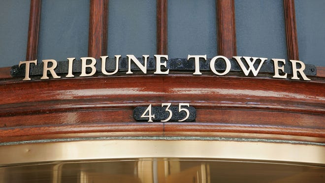 Brass letters mark the entrance of the Tribune Tower in Chicago.