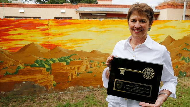Maureen Ponce Singleton holds the Key to the City of San Elizario, the first one ever given out. San Elizario Mayor Maya Sanchez presented the key to Singleton shortly before Singleton signed over 150-acres of land to the City of San Elizario. The land which at one time was home to Surratt Farms until the 2000's is now known as Valley Feed Mills was donated by the Maureen Ponce Singleton Trust.