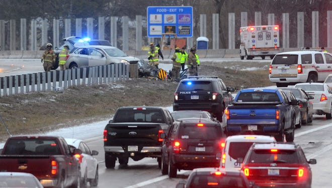 Emergency crews on the scene of an accident on southbound U.S 127 on Thursday, Jan. 12, 2017, just north of East Grand River Avenue. Police said Friday a 37-year-old woman Carson City woman died in the crash.