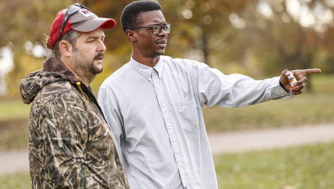 Mat Davis, right, food justice coordinator at the Flanner House, speaks with Jonathan Lawler, owner and operator of Brandywine Creek Farms, about testing the soil near the Flanner House in preparation to develop a farm on 2 1/2 acres in the heart of the largest food desert in Indianapolis on Nov. 11, 2016.