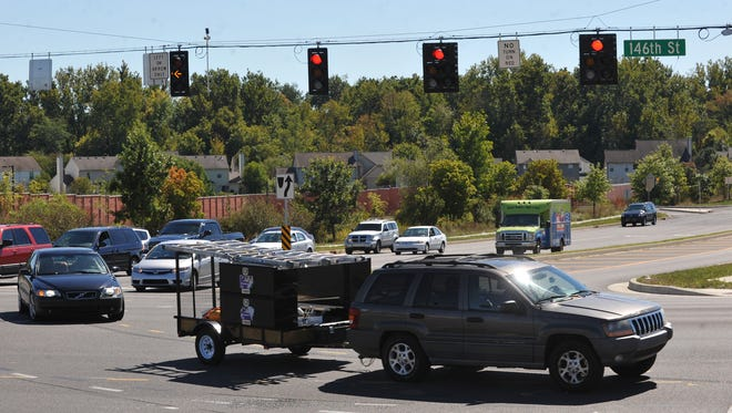 Traffic turns east from Lowes Way onto eastbound 146th Street in Carmel Monday September 23, 2013. Hamilton County and Carmel will build a southbound ramp to link 146th Street and Keystone Parkway.