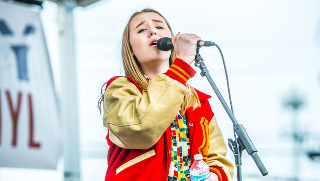 Addison Agen performs Sunday outside Indy CD & Vinyl.