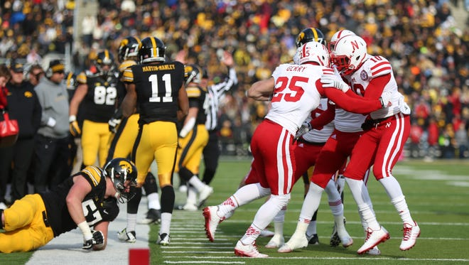 Nebraska players celebrate after defensive back Nate Gerry intercepted a pass during Friday's Big Ten Conference game in Iowa City. The Hawkeyes also lost three fumbles in the contest.