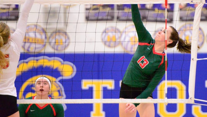 Oak Harbor's Rachel Rayburn tries for a kill Thursday in a setback to Toledo Central Catholic.