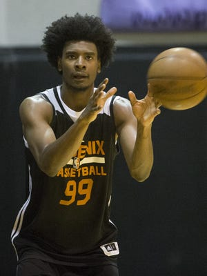 Phoenix Suns forward Josh Jackson catches a pass during practice at Talking Stick Resort Arena in Phoenix, Ariz. July 5, 2017. The team is preparing for the NBA Summer League in Las Vegas.