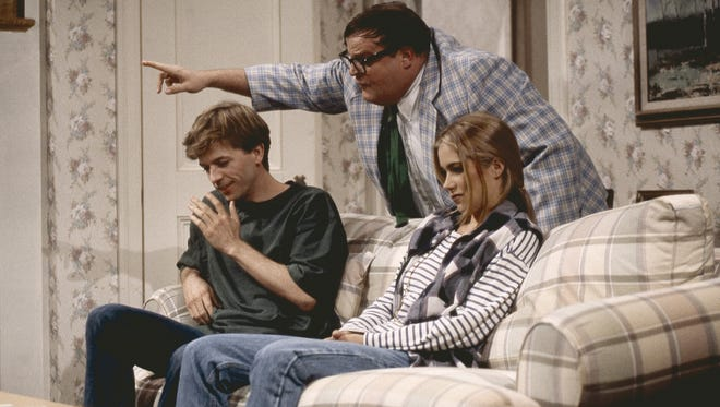Chris Farley plays motivational speaker Matt Foley in his famous 'Saturday Night Live.' The late comedian's costume is now on display in New York.