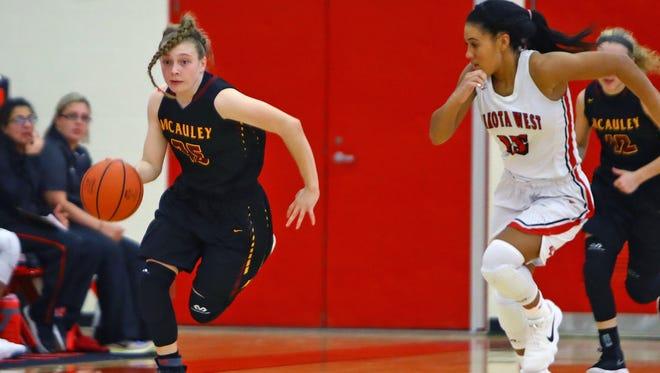 McAuley guard Lexi Fleming goes on a fast break in the game against  Lakota West. Lakota West won  53-48.