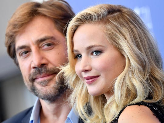 Jennifer Lawrence, right, and Javier Bardem pose during