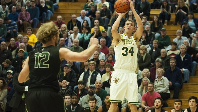 Vermont's Kurt Steidl (24) shoots a three pointer during the men's basketball game between the Dartmouth Big Green and the Vermont Catamounts at Patrick Gym on Wednesday December 7, 2016 in Burlington