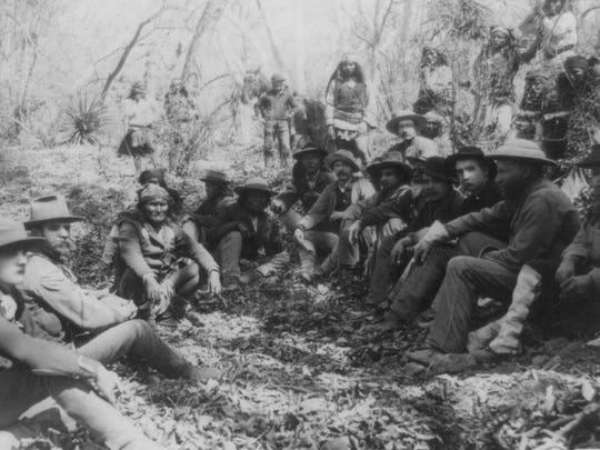 This 1886 photograph taken by Camillus S. Fly shows a council between Gen. George Crook and Geronimo discussing terms of a surrender. Government troops, three interpreters and other Apache Indians attended.