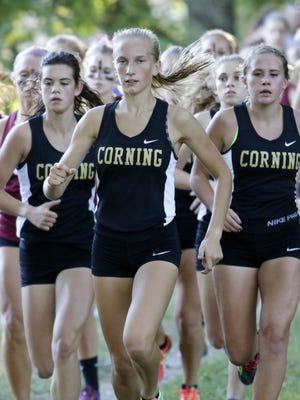 Corning senior Jess Lawson leads a pack of runners on her way to a win in the girls race Tuesday at the STAC West championship meet at Pirozzolo Park in West Elmira.