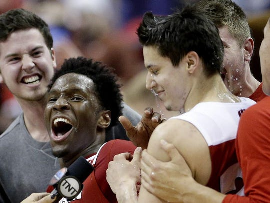 Badgers guard Bronson Koenig, right center, is congratulated by teammates after he hit the winning shot against Xavier.