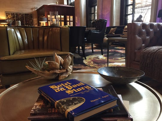 The newly designed lobby at the Hotel du Pont features books highlighting local history.