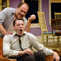 "Oscar, played by Bruce Meahl, rubs the back of roommate Felix (Reed Halvorson) in Centre Stage's ""The Odd Couple,"" opening Thursday, Sept. 10. Oscar and Felix are great friends but terrible roommates."