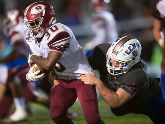 Oak Ridge's Jordan Graham is grabbed by Campbell County's