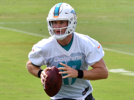 Miami Dolphins quarterback Ryan Tannehill (17) throws