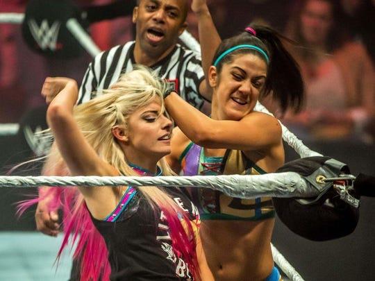 Wrestler Bayley introduces Alexa Bliss to the turnbuckle
