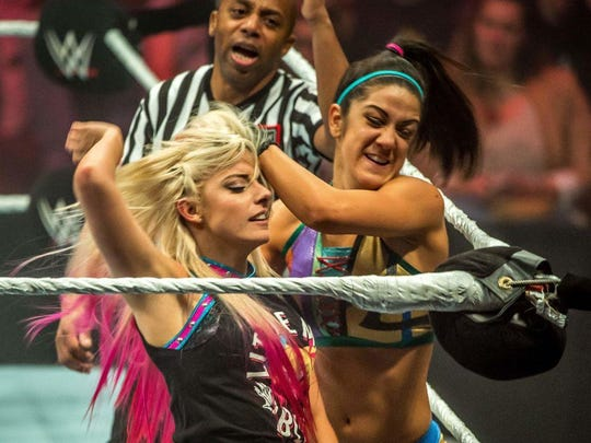Wrestler Bayley introduces Alexa Bliss to the turnbuckle during the WWE show at Zenith Arena on may 09, 2017 in Lille, France.