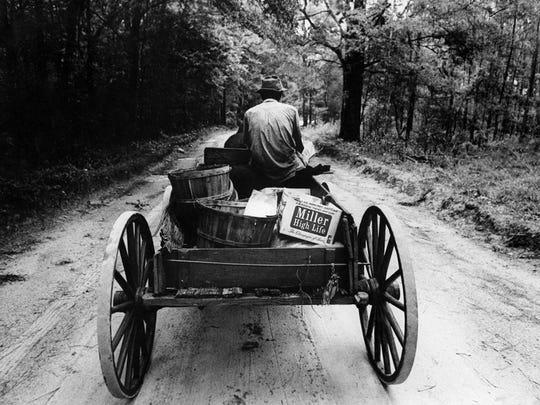 Leon County farmer Robert Jackson in one of the 1970 Pulitzer Prize-finalist photos by then-Democrat photographer Earl Warren.
