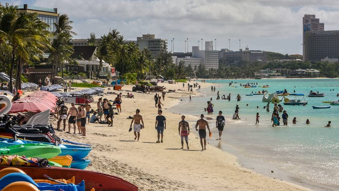 Beachgoers enjoy a day of sun and sand along Tumon Bay, as seen in this file photo.